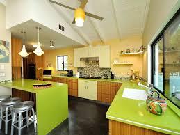 green tile back splash custom cabinets spice rack range top hood