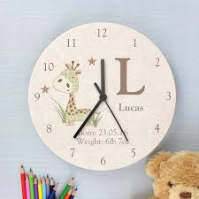 personalised giraffe or rabbit design wooden clock by letteroom