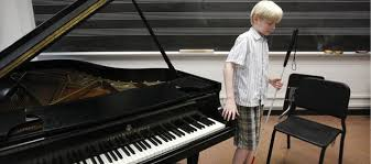 Blind Pianist Grand Pianist 12 Year Old Plays Through Blindness Lawrence Com
