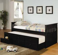 dark brown polished wooden trundle bed frame with headboard