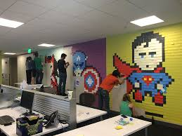 pictures for office walls bored employee uses 8 024 post it notes to transform boring office