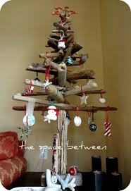 homemade driftwood christmas tree decorated with diy ornaments