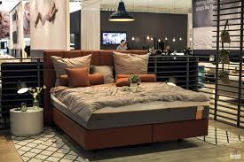 gray queen size bed integrated with pastel orange frame and