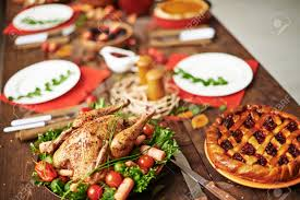pie and roasted chicken on served thanksgiving table
