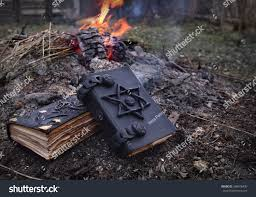 the background of halloween two magic books lying on ashes stock photo 348976430 shutterstock