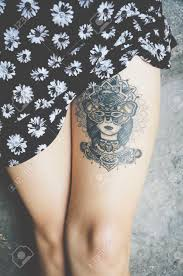 attractive female leg with tattoo stock photo picture and royalty
