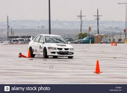 a white 2003 mitsubishi lancer evolution viii in an autocross race