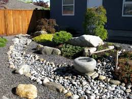 front yard with river rock and japanese fountain river rock