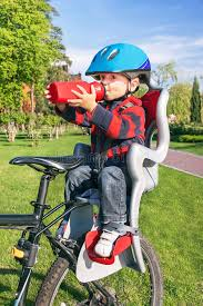 Helmet Chair Baby Boy Is In The Bicycle Chair Seat Stock Photo Image 40986140