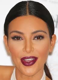 middle part bun 50 best kim kardashian hairstyles
