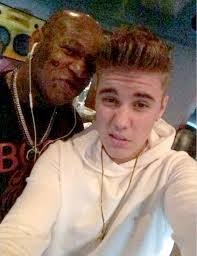 this kid had his birthday justin bieber under wing of rapper birdman who lends him 2m