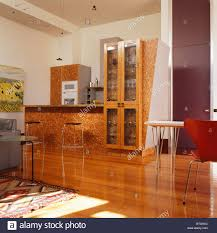 lacquered wood chip surface on fitted units in modern kitchen with