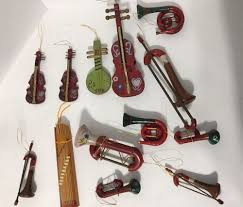 13 wooden painted miniature musical instrument