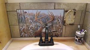 Rustic Cabin Bathroom - deer decorative tiles in rustic cabin bathroom tile backsplash