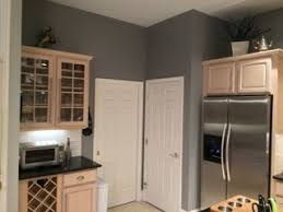 i have pickled oak cabinets and want to paint my walls gray light