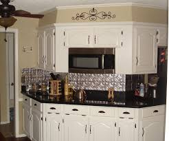 white fabulous white kitchen cabinet and tin backsplash with
