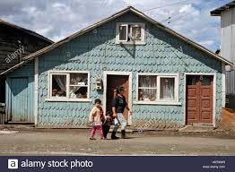 typical shingled duplex house in castro chile on the island of