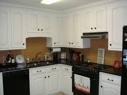 blue kitchen with black appliances beige bevel stone tile