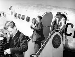 king george vi men disembarking from a trans canada air lines plane during visit
