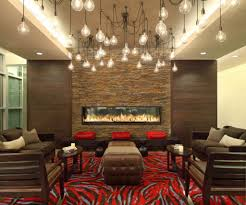 living room with sofas and fireplace also multiple pendants the