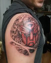 ripped skin transformer logo tattoo on man right shoulder