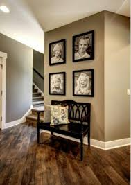 entryway idea i love the bench pillows and photos entryway