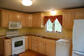 decor oak kitchen cabinets with roman blinds and ceiling lights