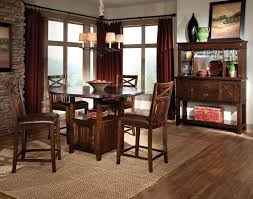 Round Rugs For Under Kitchen Table by Brown Rug Under Rounded Glass Top Dining Table Combined With