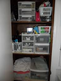 organization solution for a deep bathroom closet u2014 simply frugal