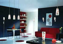 small living room design with bold black wall color and red sofa