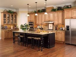 maple cabinets with black island picture of honey colored oak cabinets with dark wood floor and black