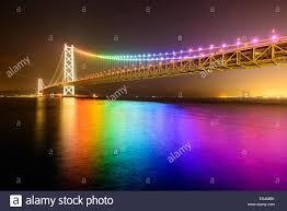 rainbow lights on akashi ohashi pearl bridge in japan