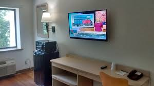 desk and large wall mounted flat screen tv great cable choices