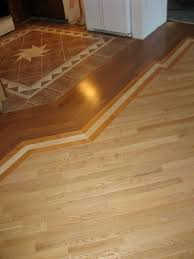 Floor Tiles For Kitchen by How To Mix Hardwood And Ceramic Tile Flooring In Different Rooms