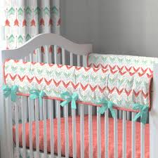 crib rail cover in coral and teal arrow by carousel designs a