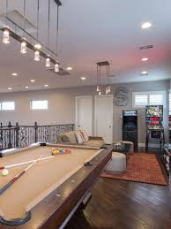 drew and jonathan scott u0027s chic loft game room features a pool