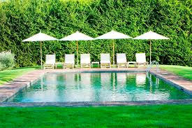 at home arkansas pool time market umbrellas swimming grass lawn
