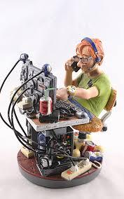 computer geek gift statue of computer programmer at desk