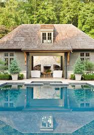 round in ground pool with pool house transitional garden