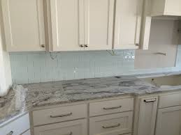 white kitchen cabinet marble countertop white gray backsplash tile
