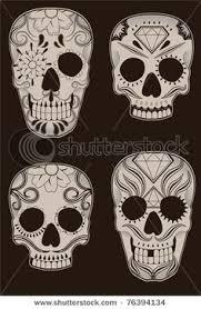 set of sugar skulls by transfuchsian via dreamstime