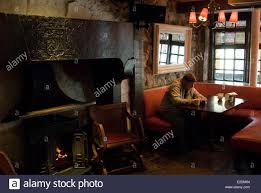 ireland galway county galway lonely man in a pub peat fire stock
