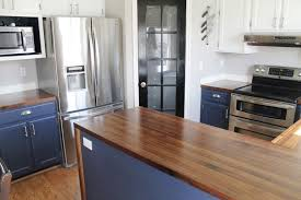 our walnut countertops sanded sealed and finished chris loves we have a few navy paint touch ups to do and some tape and bags to remove but we honestly couldn t be happier with the countertops themselves