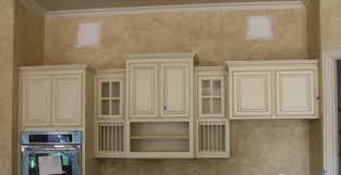 How To Glaze White Kitchen Cabinets by Classical Glazed White Painted Kitchen Cabinet Mixed Modern Black