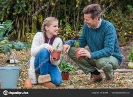 happy family garden happy family man child father daughter gardening u2014 stock
