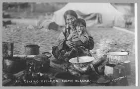 file inuit woman and child cooking outdoors in nome in 1916 jpg