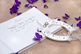 purple wedding guest book opened wedding guest book with a luck horseshoe and purple