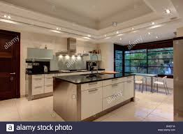 down lighting on false ceiling in modern spanish kitchen with