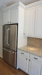appliance cabinets kitchens refrigerator side panels wood over the refrigerator storage ideas