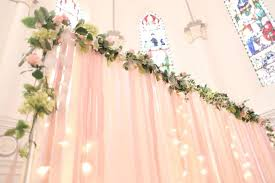 wedding backdrop singapore soft pink ribbon backdrop with fairy lights and garlands